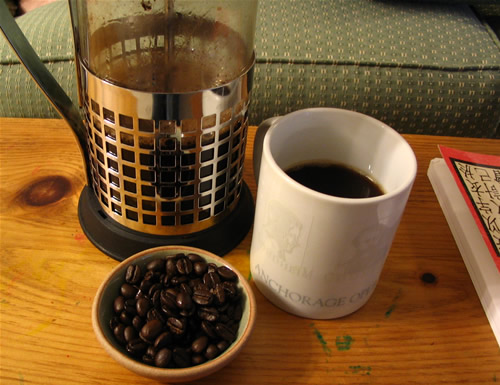coffee cup with beans example and carafe